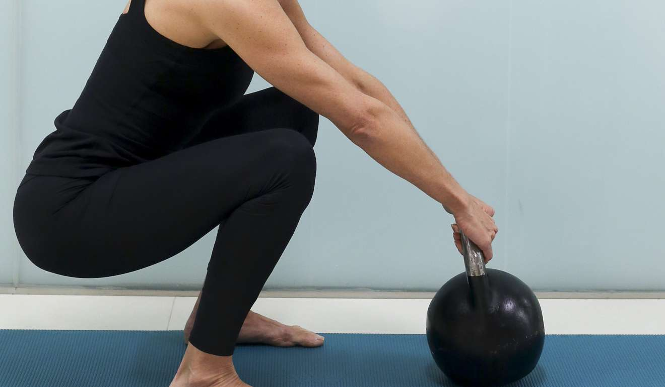 Lifting kettlebells.