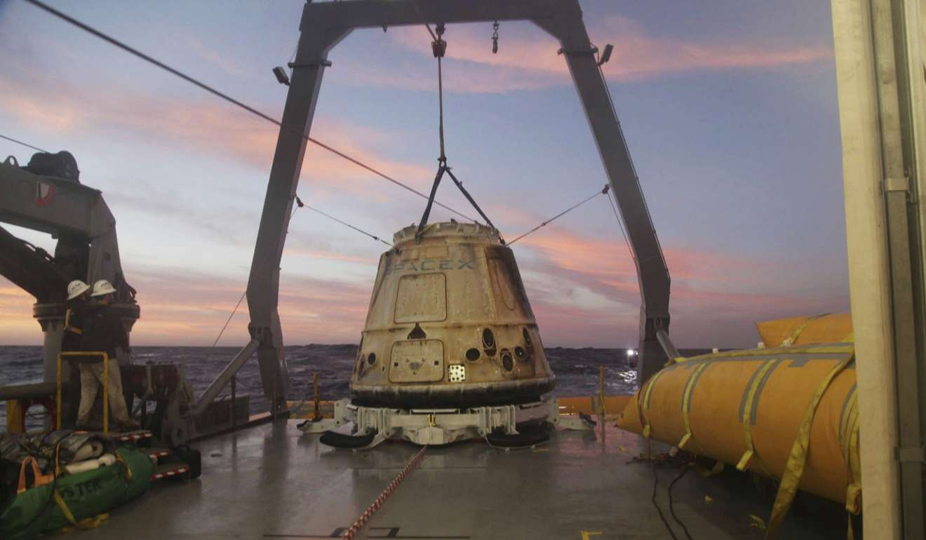 Spacex Announces It Will Fly Two People Around The Moon Next Year A Diagrams Dragon School Of Motoring Capsule Sits Aboard Ship In Pacific Ocean West Mexicos Baja Peninsula After Returning From International Space Station 2015