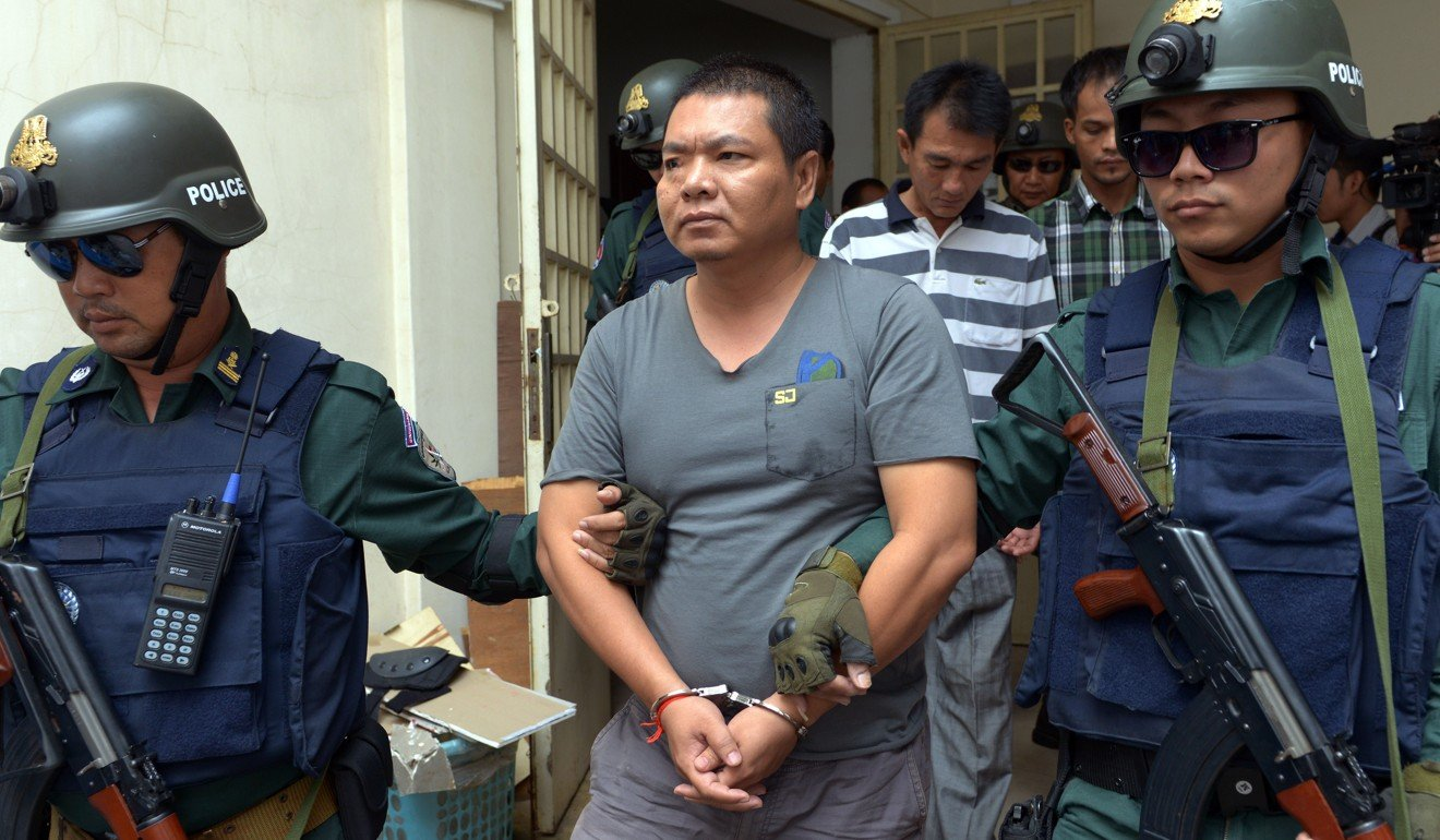 War on drugs in Cambodia - Cambodian police escort a suspected drug trafficker arrested in Phnom Penh. Photo: AFP