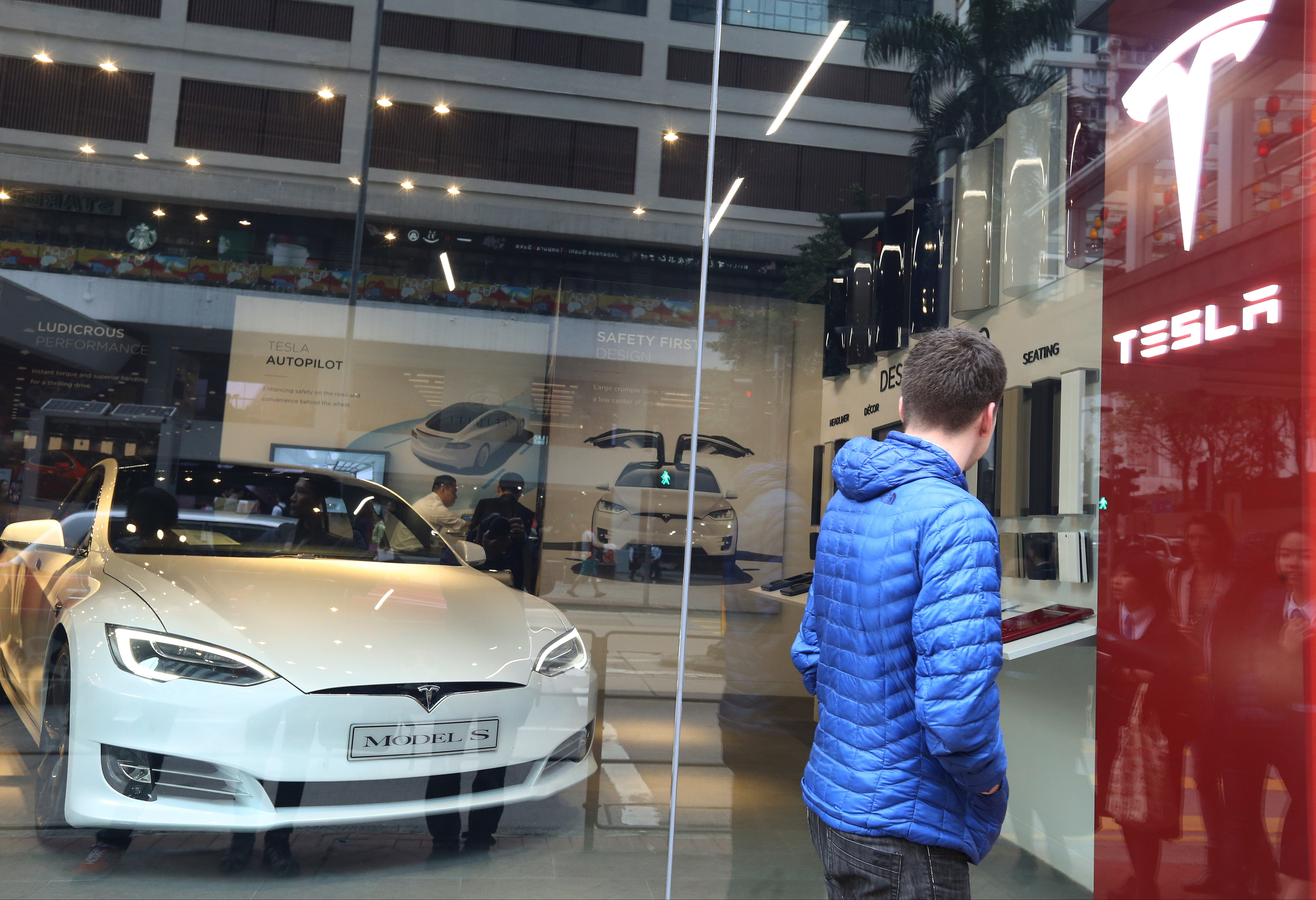 Tesla to reduce hong kong operations if city refuses to