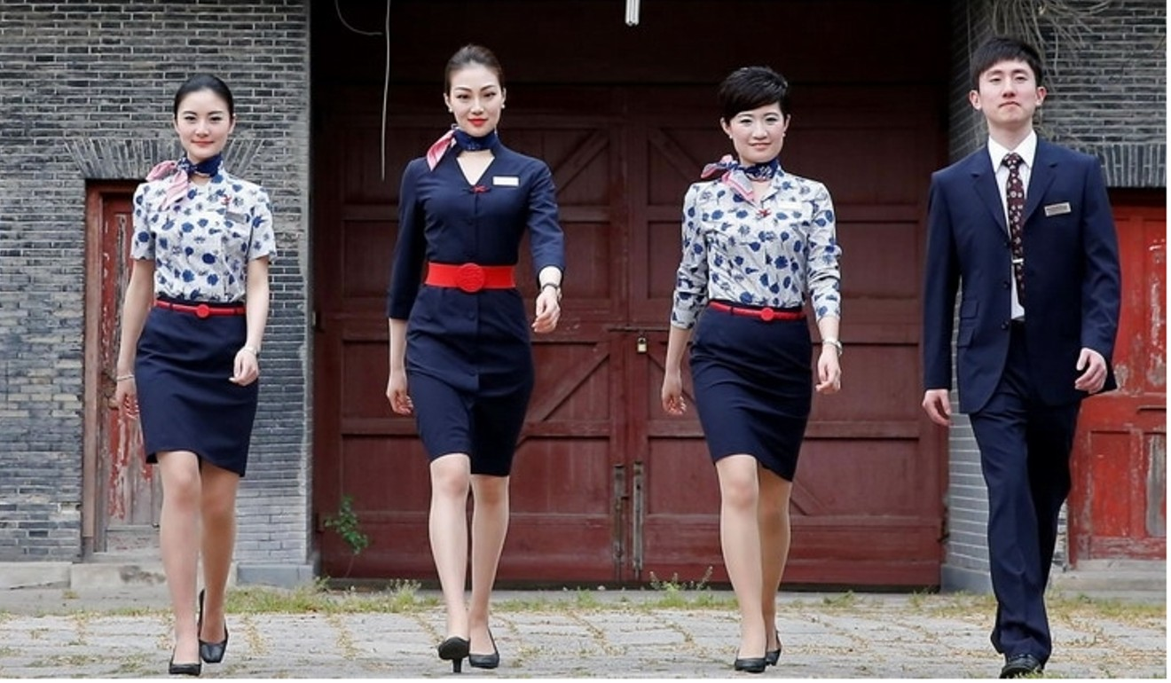 China Eastern Airline's cabin crew resplendent in navy blue.