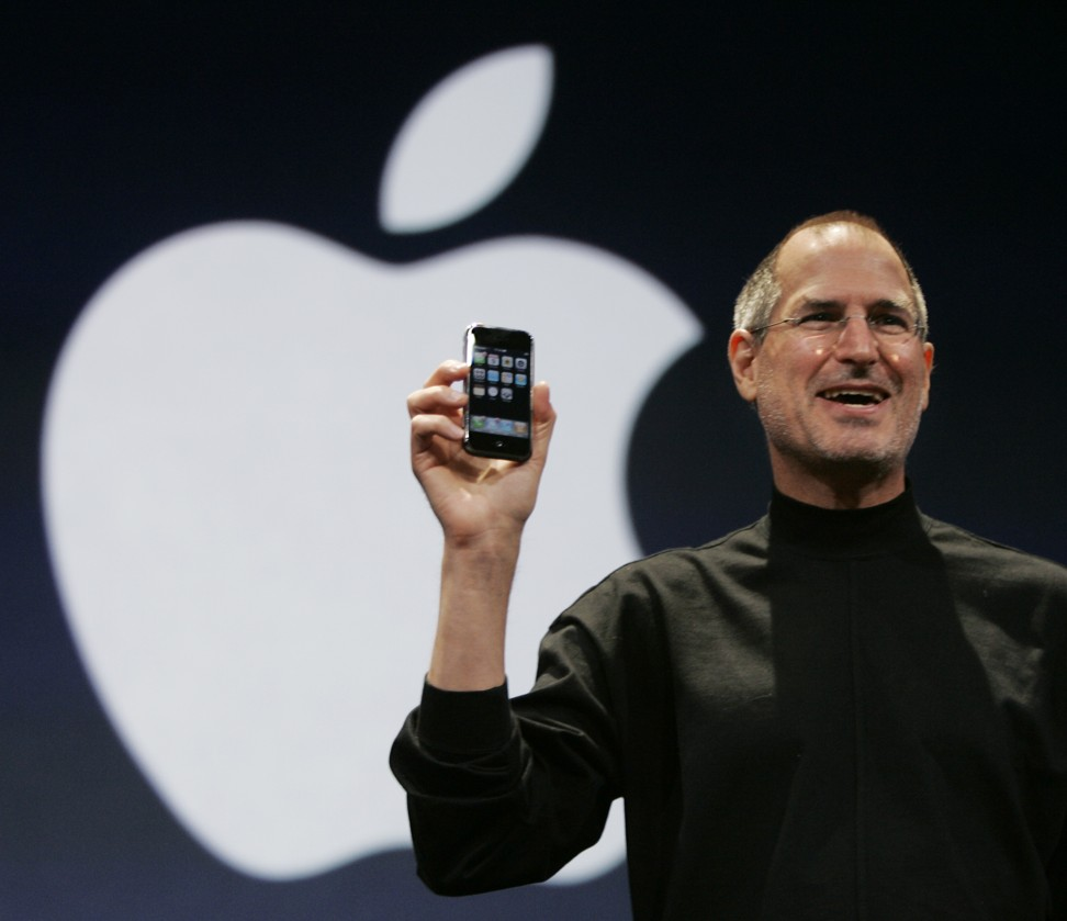 Apple CEO Steve Jobs Holds Up The New IPhone During His Keynote Address At MacWorld Conference Expo In San Francisco 2007 Photo AP
