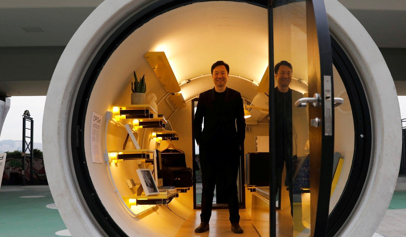 Architect James Law poses inside the OPod prototype. Photo: Reuters
