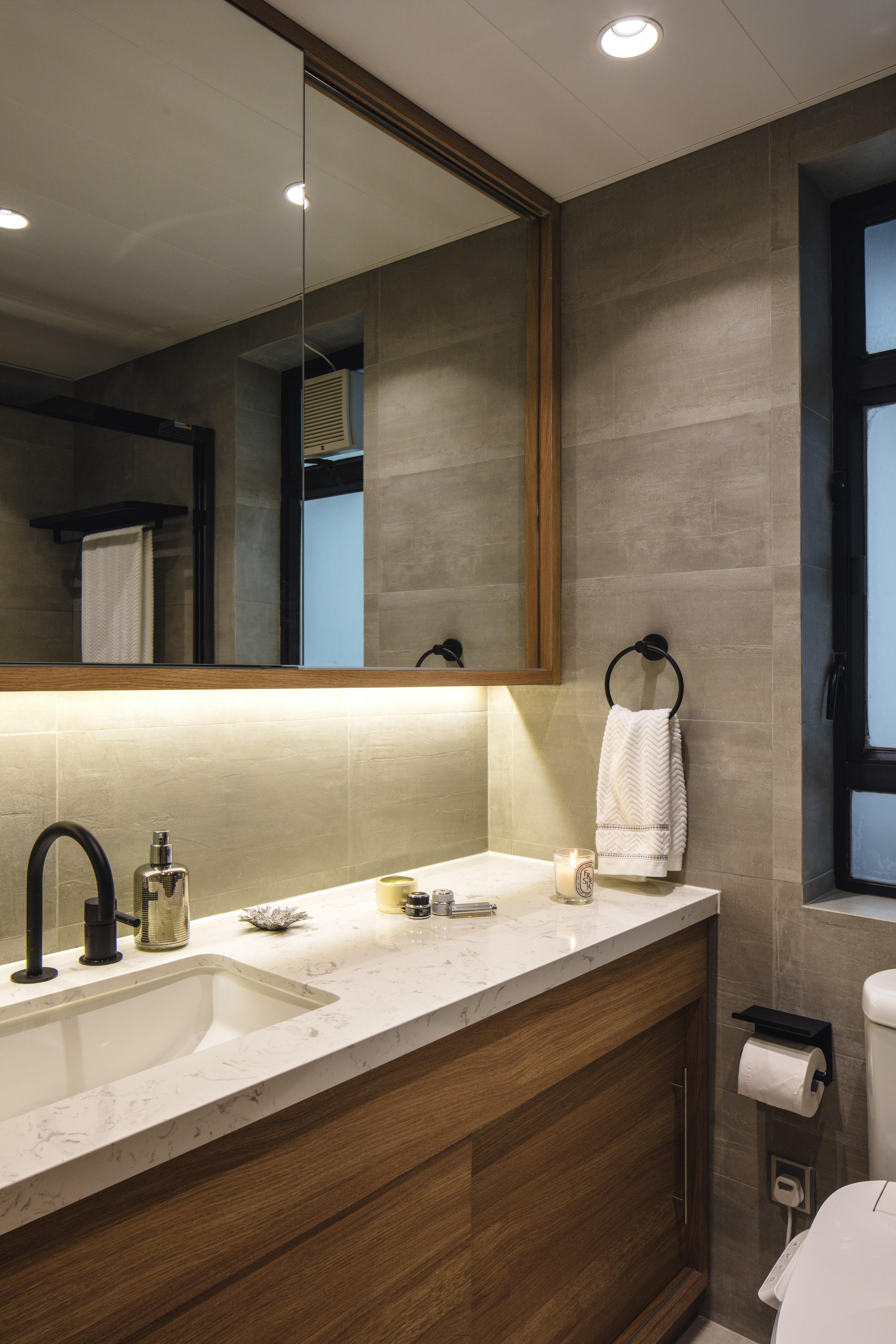 Luxurious Details Such As The Matt Black Taps And Rain Shower Elevate The  Apartmentu0027s Interior Design.
