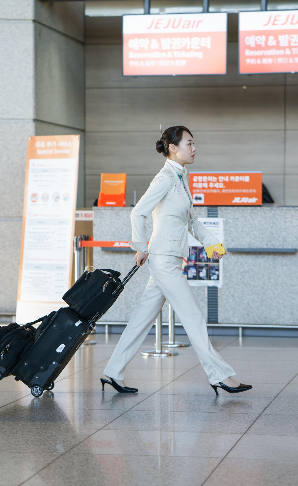 Seven airlines whose female flight attendants wear trousers – unlike Cathay  Pacific, where it's skirts only | South China Morning Post
