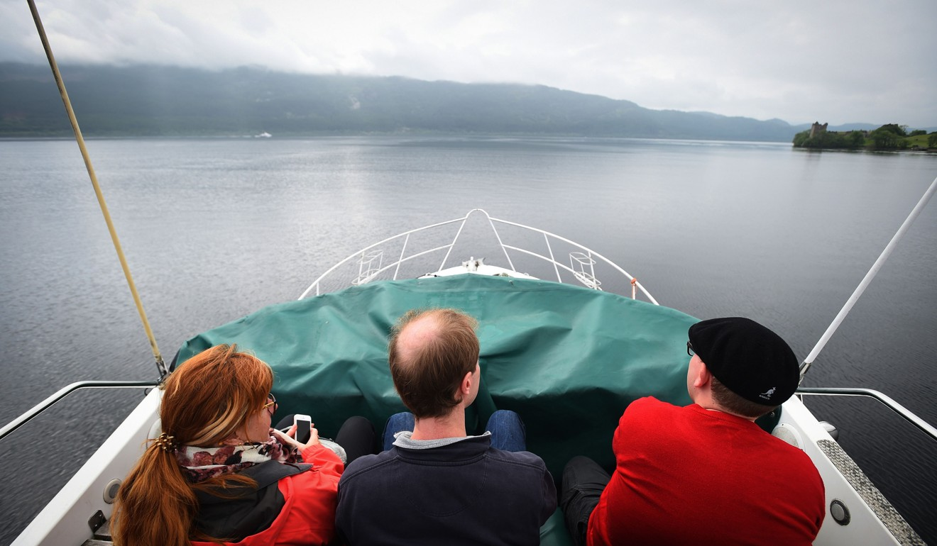 Tourists on the Nessie Hunter boat on Loch Ness. Photo: AFP