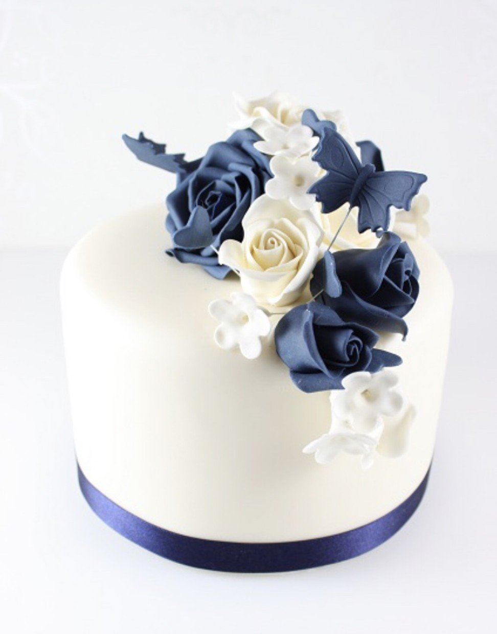 5 instagrammable birthday cakes that will make perfect social media the royal lady organic and gluten free chocolate fondant cake has white deep royal blue flowers with a white pearly finish izmirmasajfo