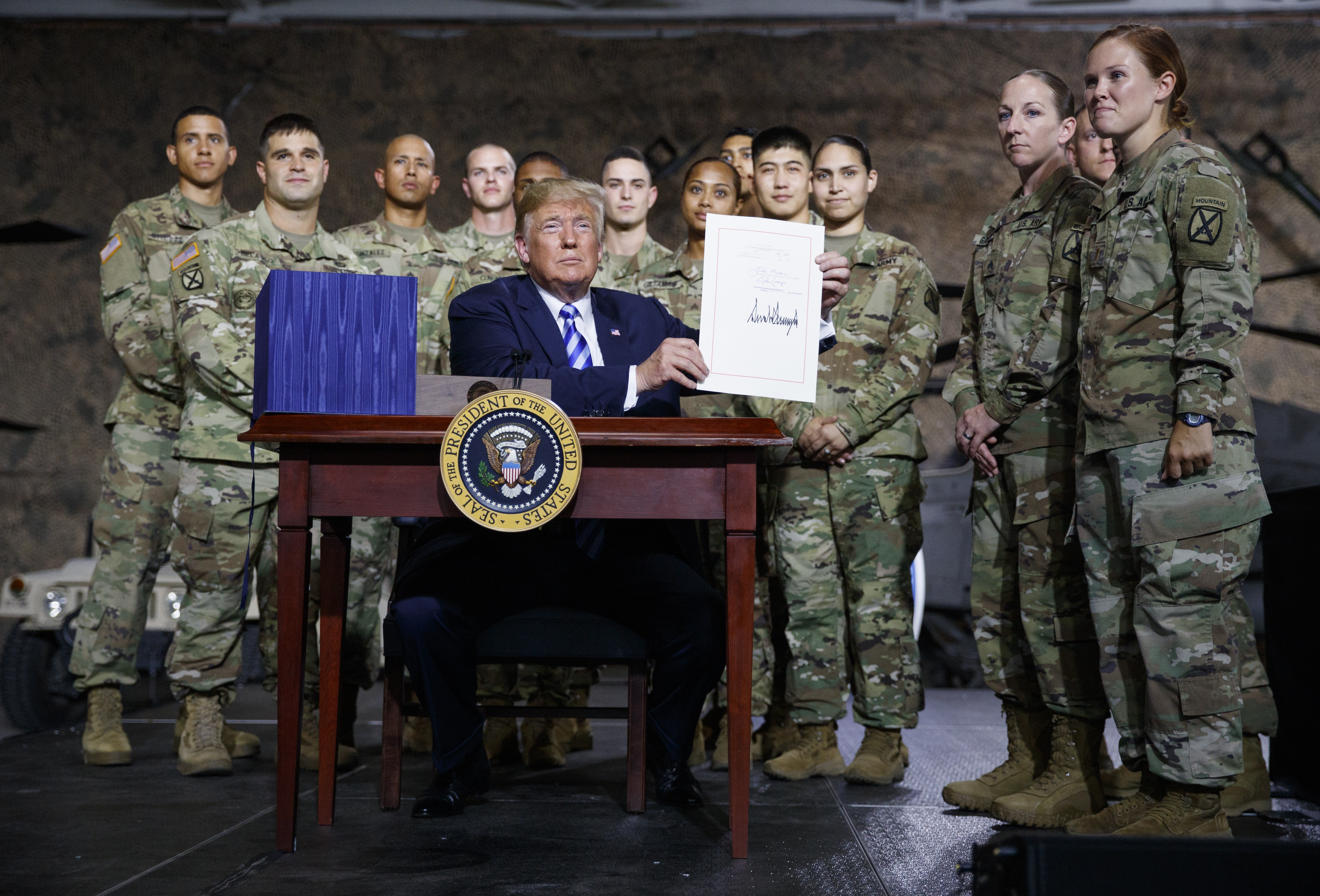 Donald Trump Signs $716 Billion Defence Policy Bill