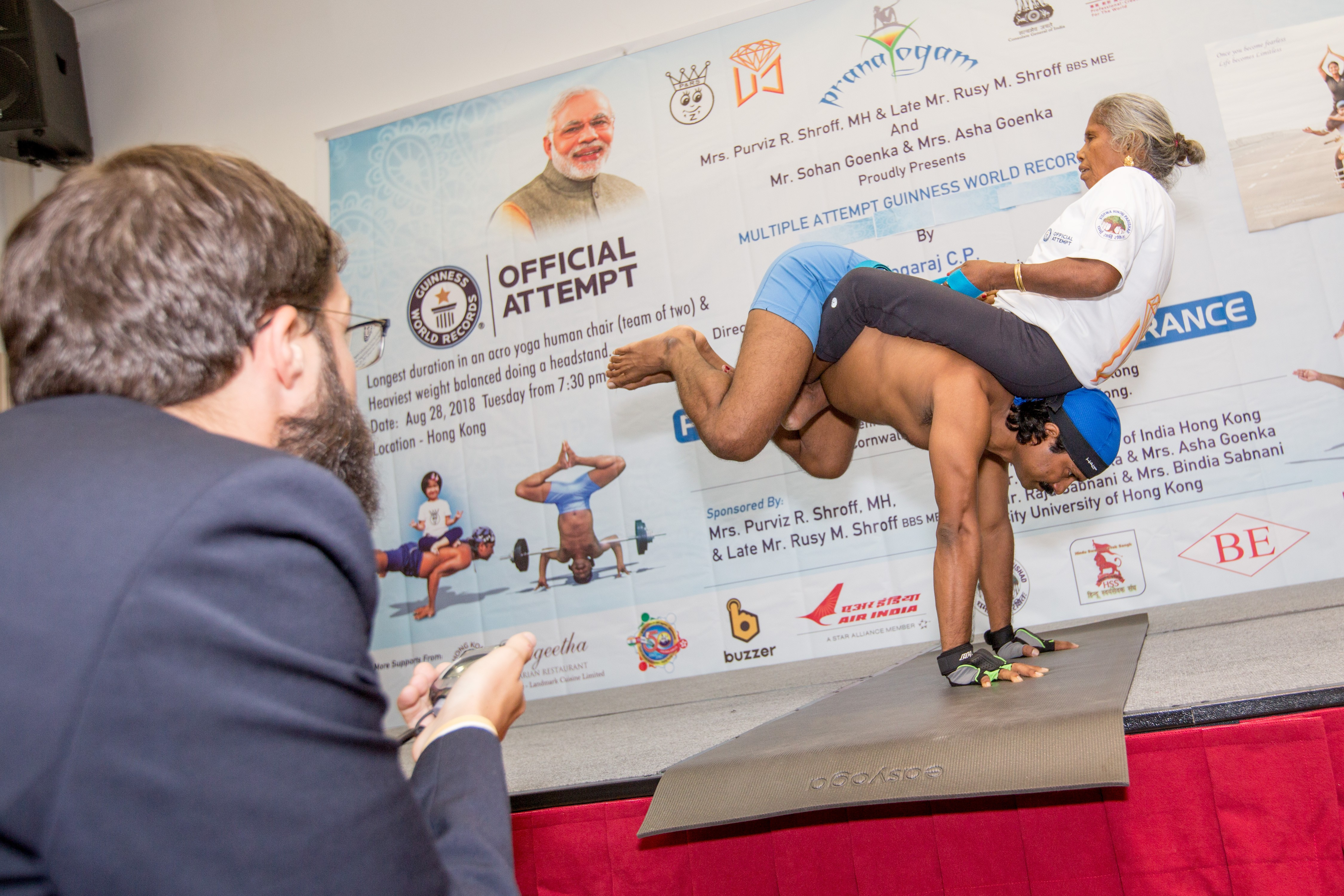 Hong Kong yogi breaks Guinness World Records for headstand and human