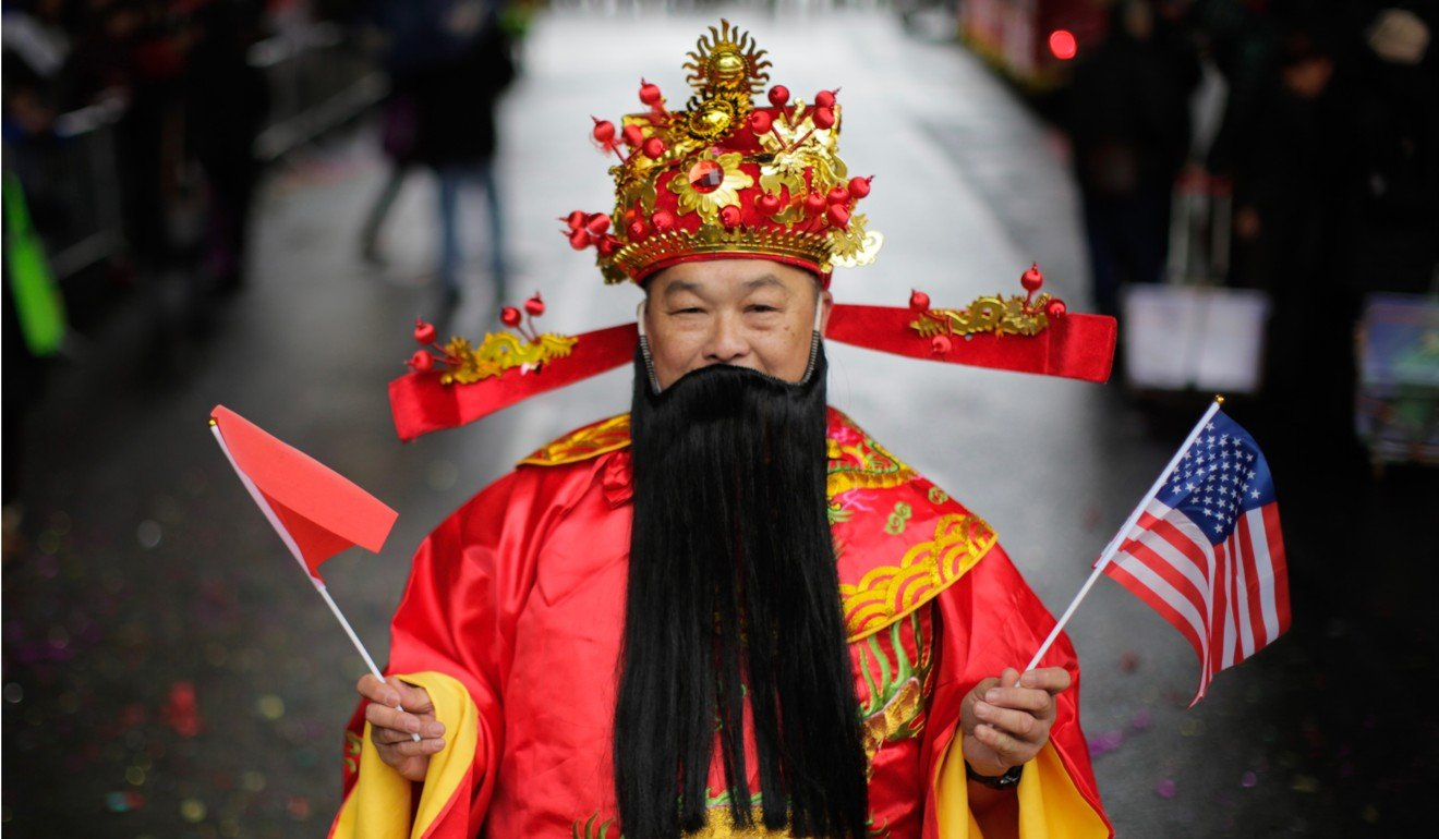 People take part in the Chinese Lunar New Year parade in Chinatown on February 25, in New York City. China lacks anything comparable to Hollywood that can spread interest in Chinese culture. Photo: AFP