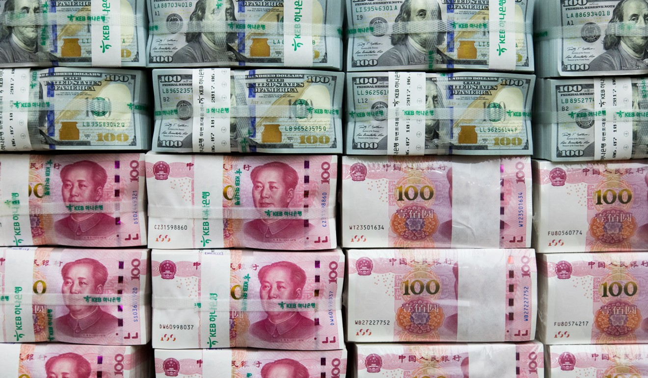 The Chinese yuan has already fallen 9 per cent against the US currency, approaching the psychologically important level of 7 per dollar. Photo: Bloomberg