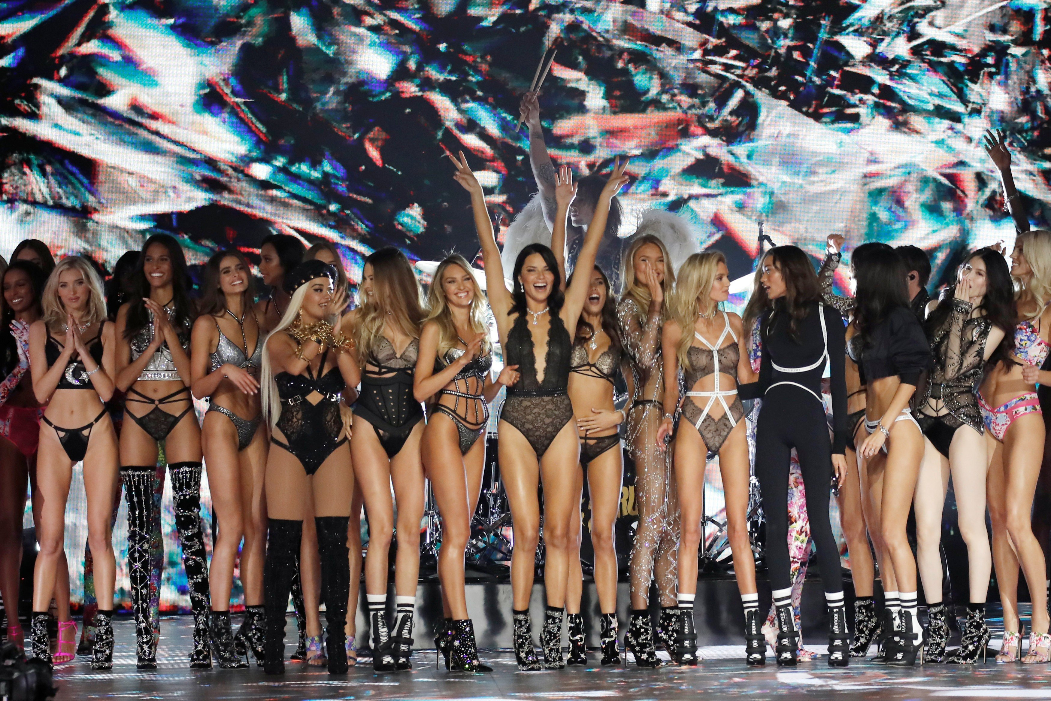 Chinese models Liu Wen and Ming Xi walk the runway at