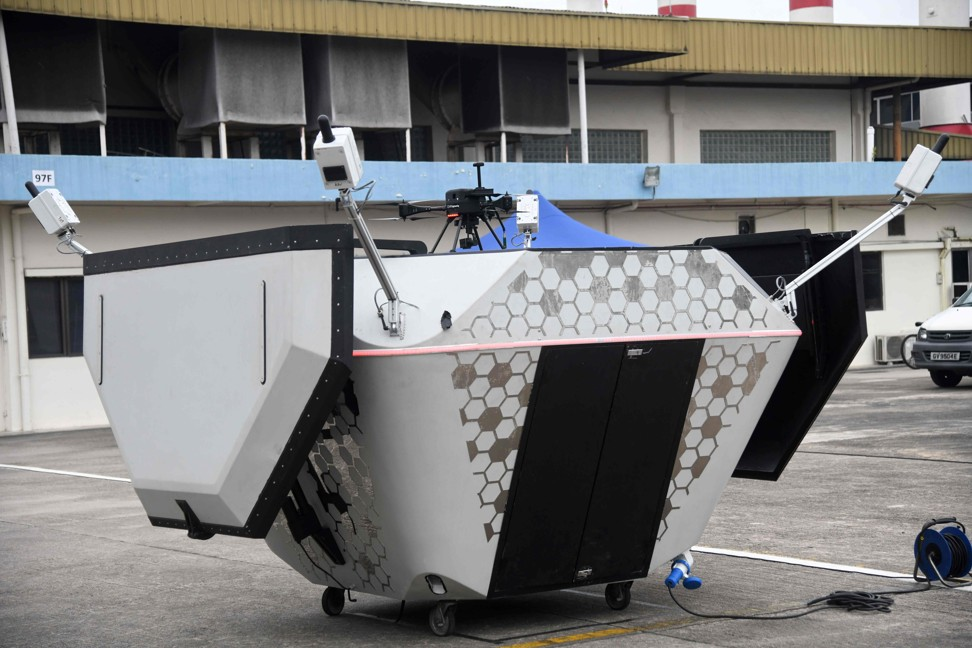 A Singapore Technology Aerospace owned drone on a mobile landing and charging station during a demonstration in Singapore. Image: AFP