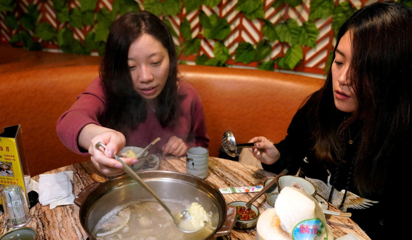 Customers eat a durian hotpot in Shanghai. Image: Reuters