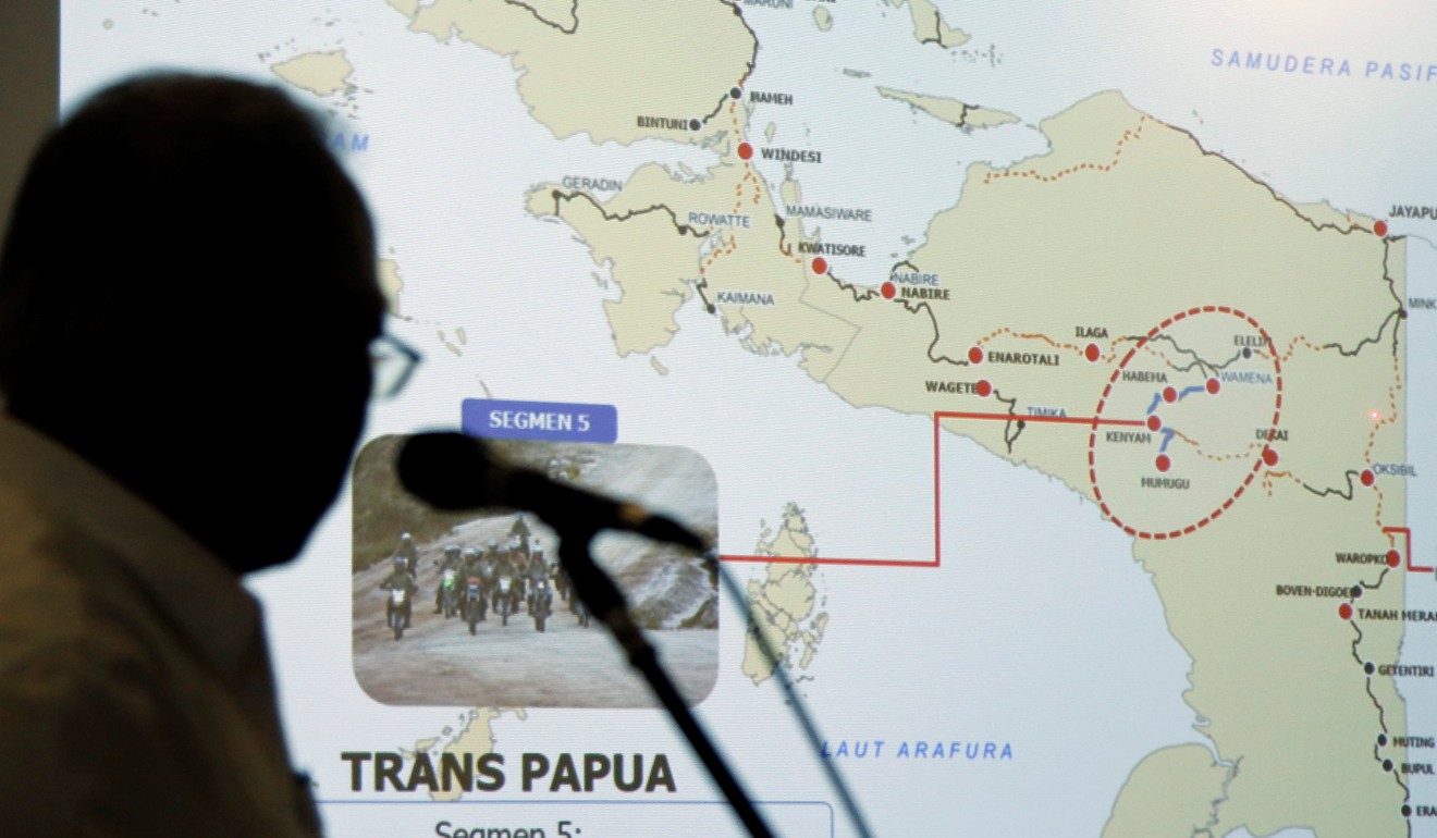 Indonesia's public works minister shows a map of the area where the killings took place. Photo: Reuters