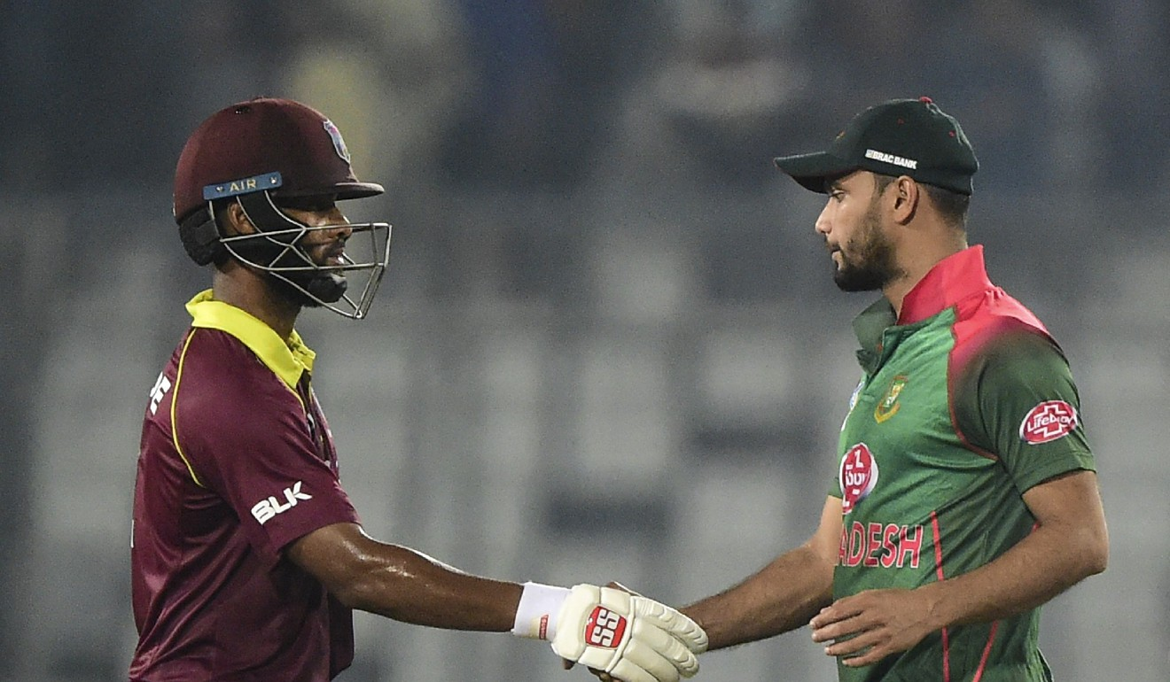 West Indies cricketer Shai Hope (left) shakes hands with Bangladesh cricket captain Mashrafe Mortaza (right). Photo: AFP
