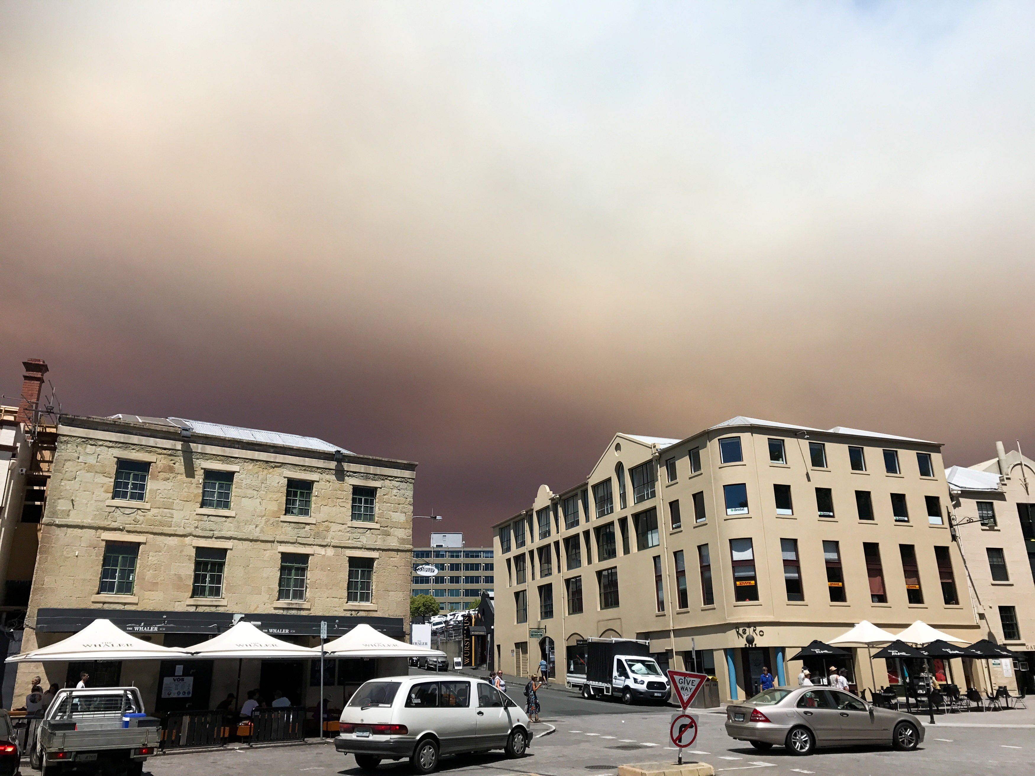 Bush fires rage in two Australia states as summer temperatures soar