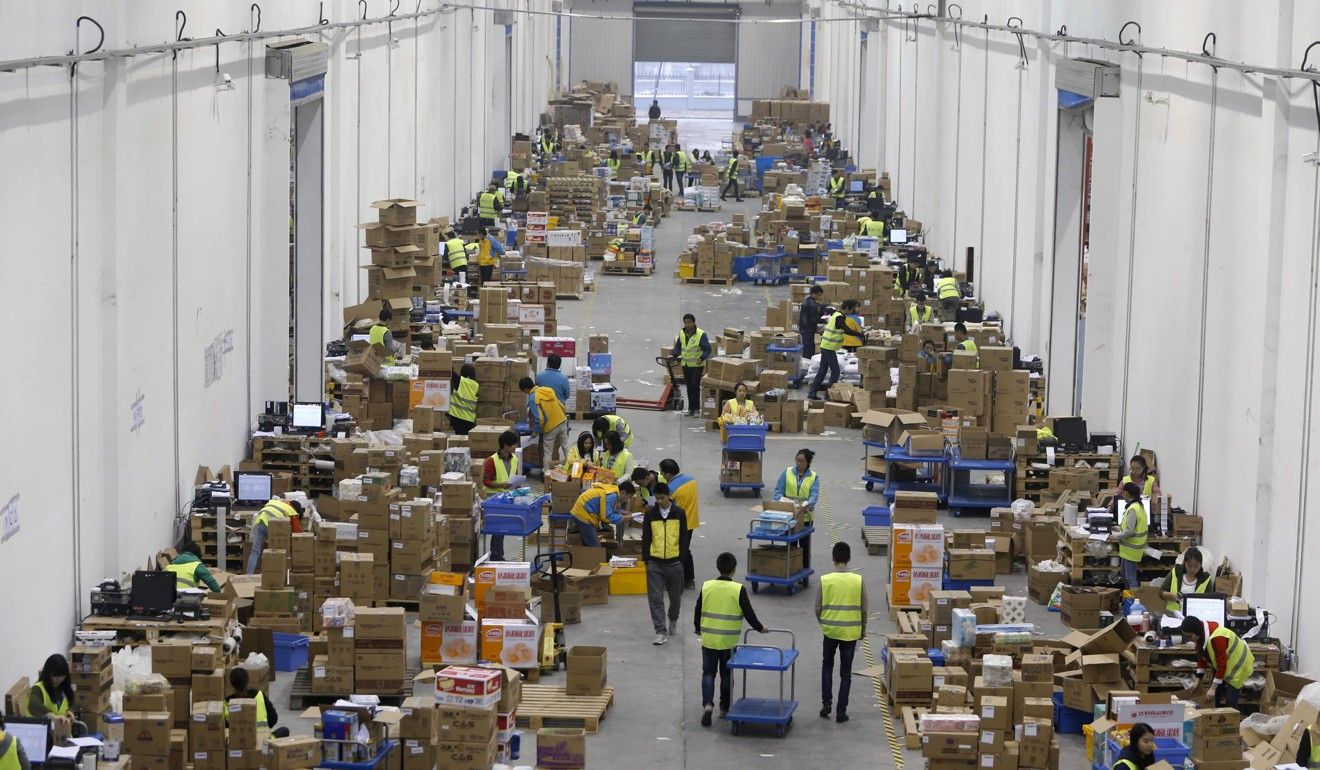 Employees sort boxes and parcels at the logistic centre of a express delivery company in Wuhan, Hubei province, a tier 2 city in China. Technological advancement has created an e-commerce boom, giving consumers in emerging regions easier access to more products. Photo: Reuters