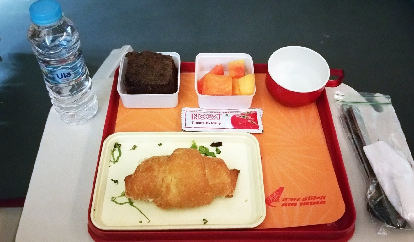 Air India's breakfast included the hardest croissant Loukas had ever tasted. Photo: Nik Loukas