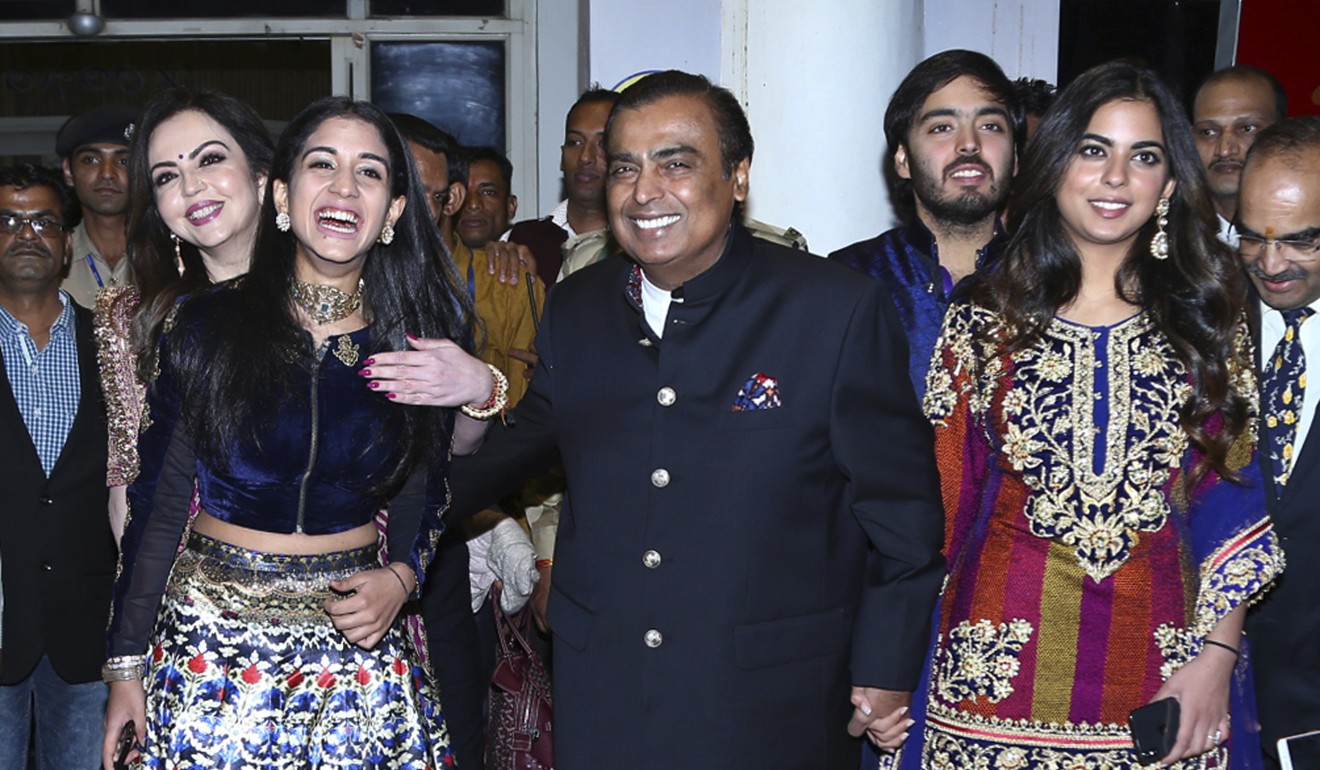 Mukesh Ambani (centre), chairman of Reliance Industries, is the world's eighth richest man, according to the Hurun Global rich list. Photo: AP