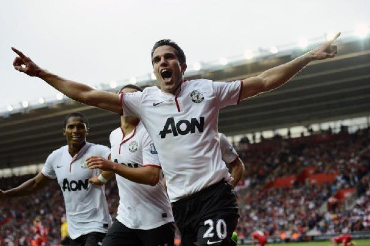 9475c141c Dutchman Robin van Persie celebrates after scoring a hat-trick for  Manchester United in their