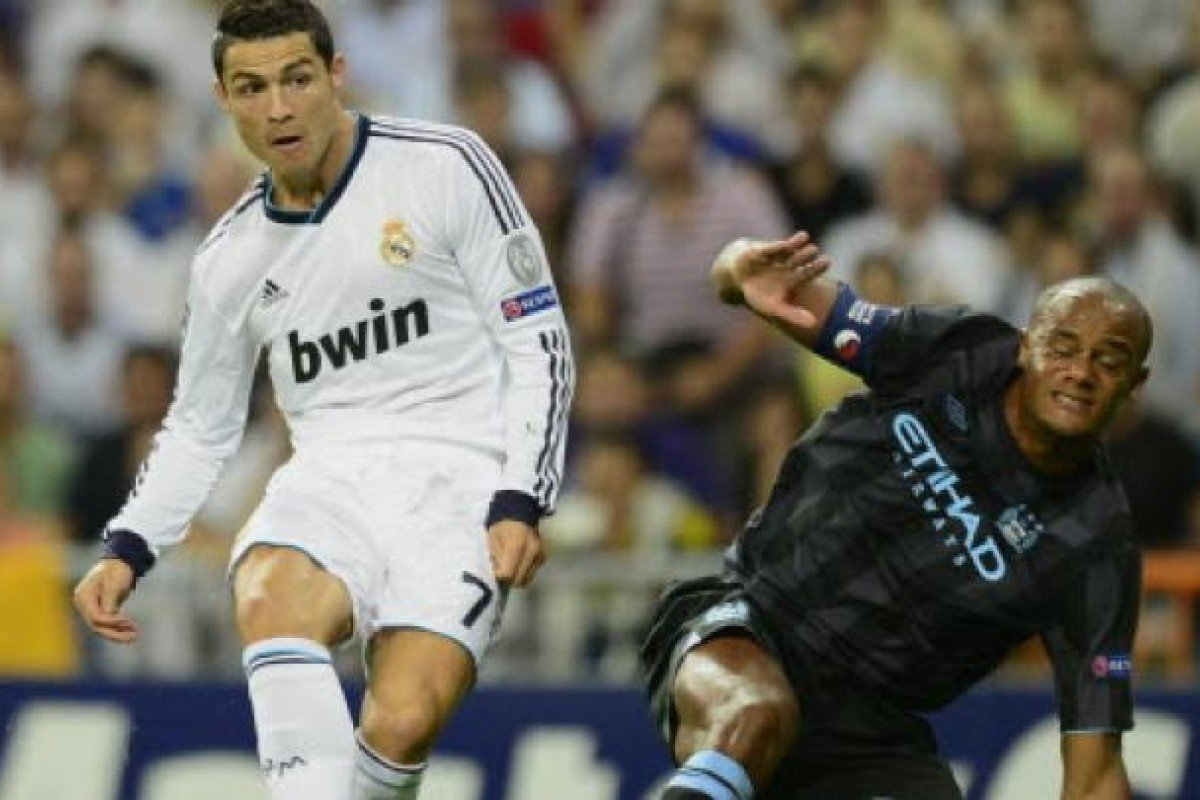 c7e03716a Real Madrid s Portuguese forward Cristiano Ronaldo (left) vies with Manchester  City s Belgian defender Vincent