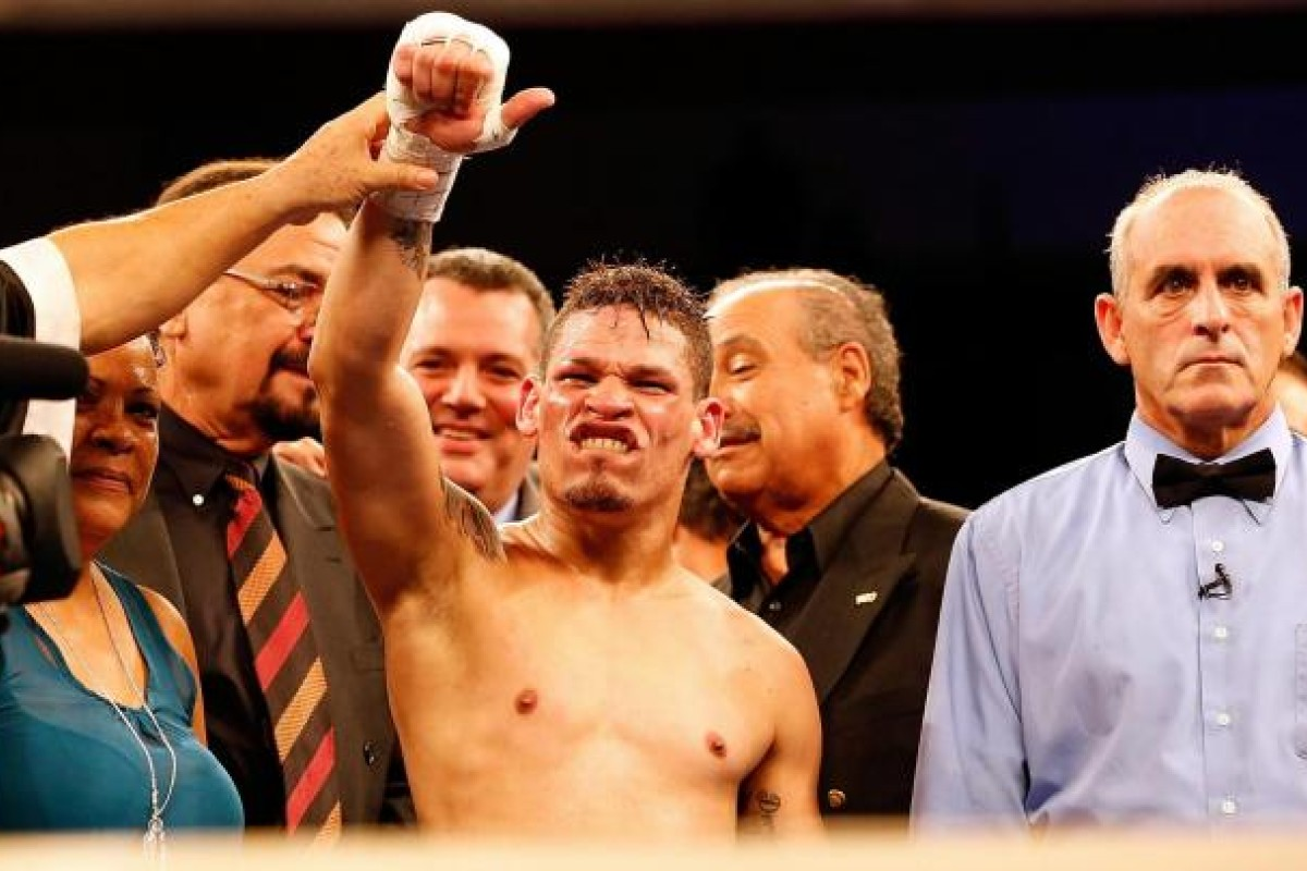 e1dadfaa8 Gay boxer Orlando Cruz has his arm raised in victory after gaining a  unanimous decision over
