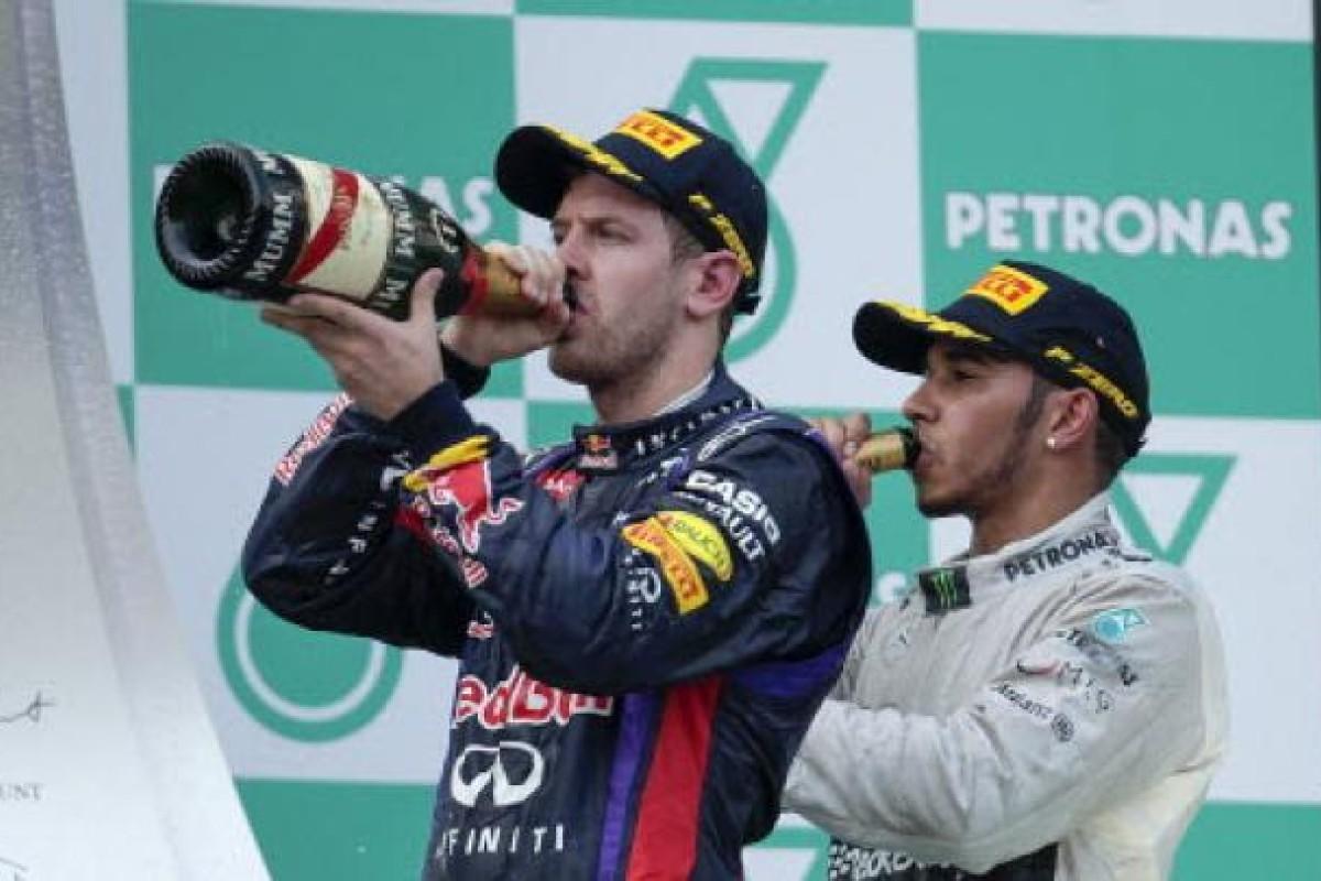32879fe7 German Formula One driver Sebastian Vettel (left) of Red Bull Racing drinks  champagne with