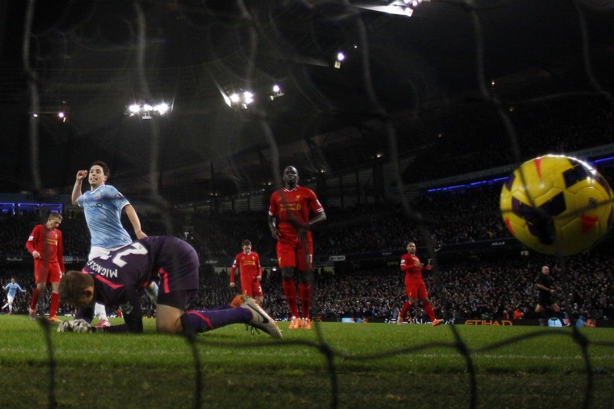 760c75b1fa4 Manchester City s Samir Nasri celebrates as Liverpool keeper Simon Mignolet  cannot keep out Alvaro Negredo s winner