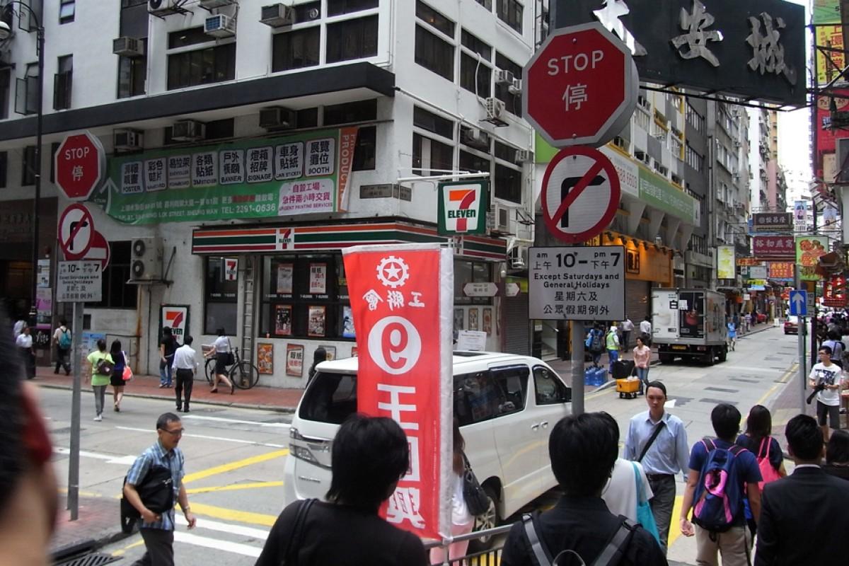Police officer draws gun in Sheung Wan as 'crazy' car thief causes