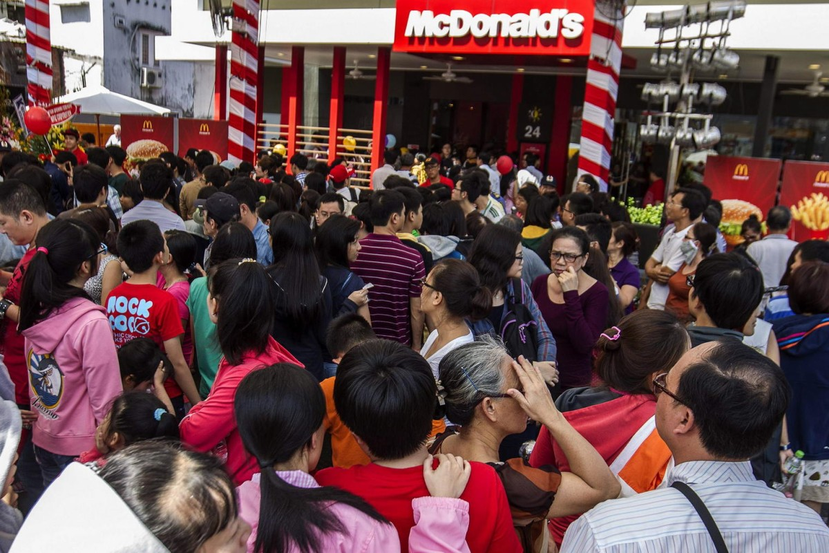 Customers queue outside Vietnam's first McDonald's on its first day of business yesterday. Photo: AFP