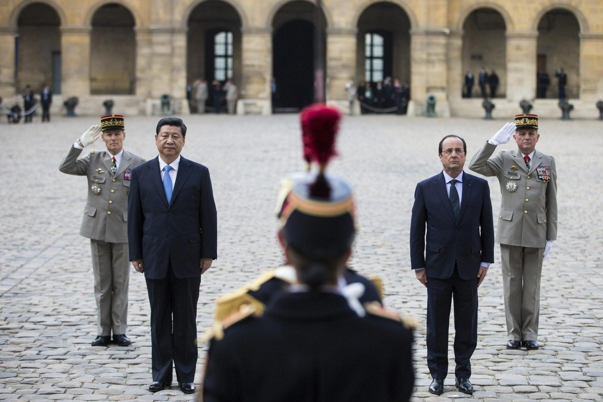 Xi Jinping and French President Francois Hollande at a ceremony in Paris. Photo: Reuters