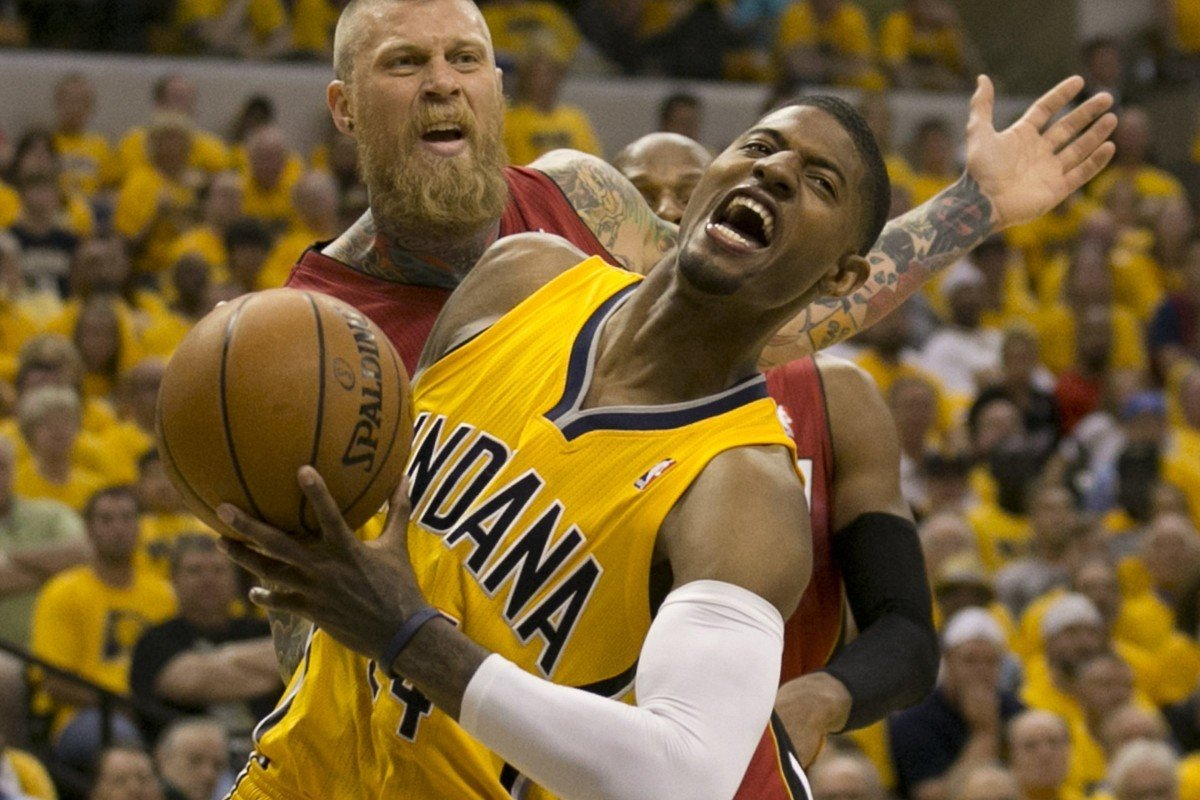 a79e803eac2 Indiana Pacers forward Paul George drives with the ball around Miami Heat s  Chris Andersen in game