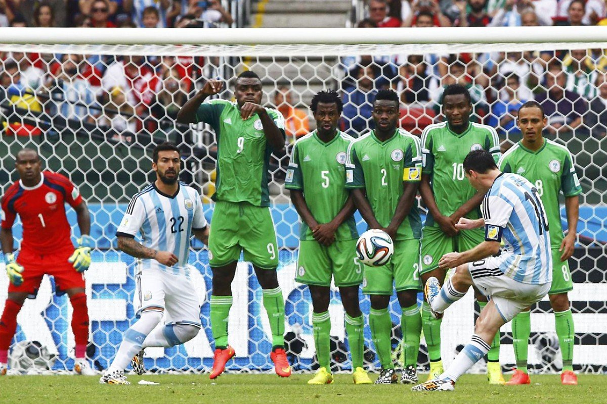 ecf4b25a8 Argentina's Lionel Messi scores from a free kick over a wall of Nigerian  players at the