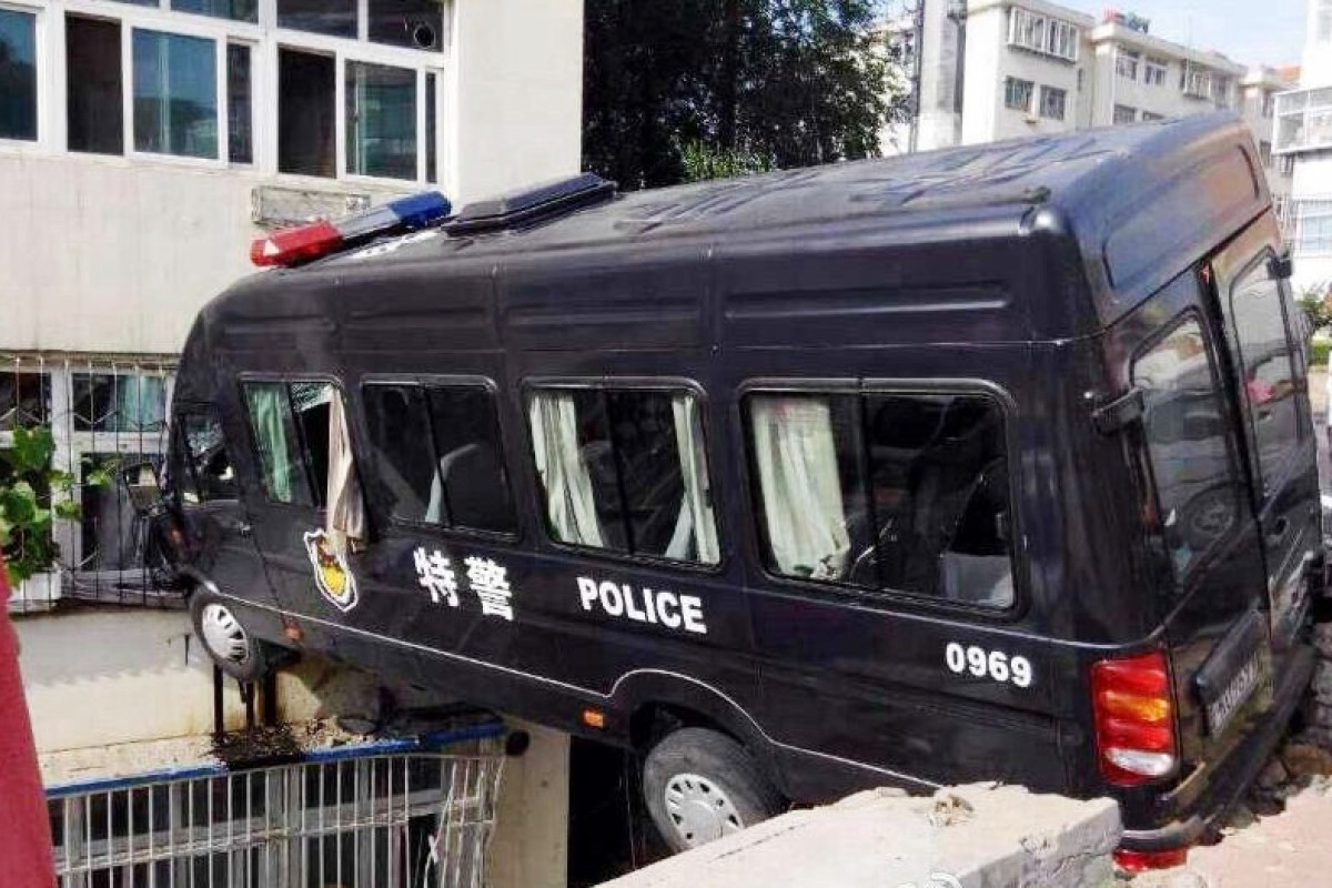 Send in the flying squad! Chinese SWAT car stuck in mid-air after