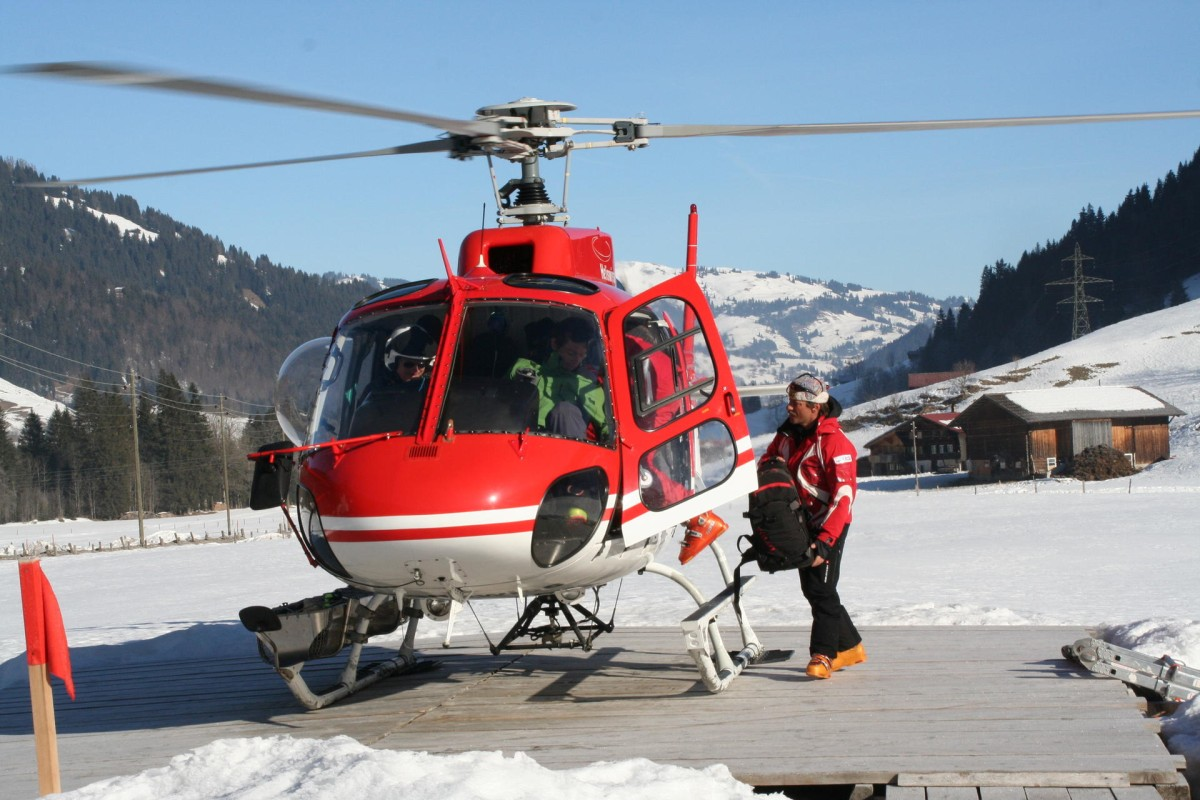 a02244fa6fe9c A helicopter at the Alpina Gastaad in Switzerland takes snowboarders to  unchartered terrain. Photos