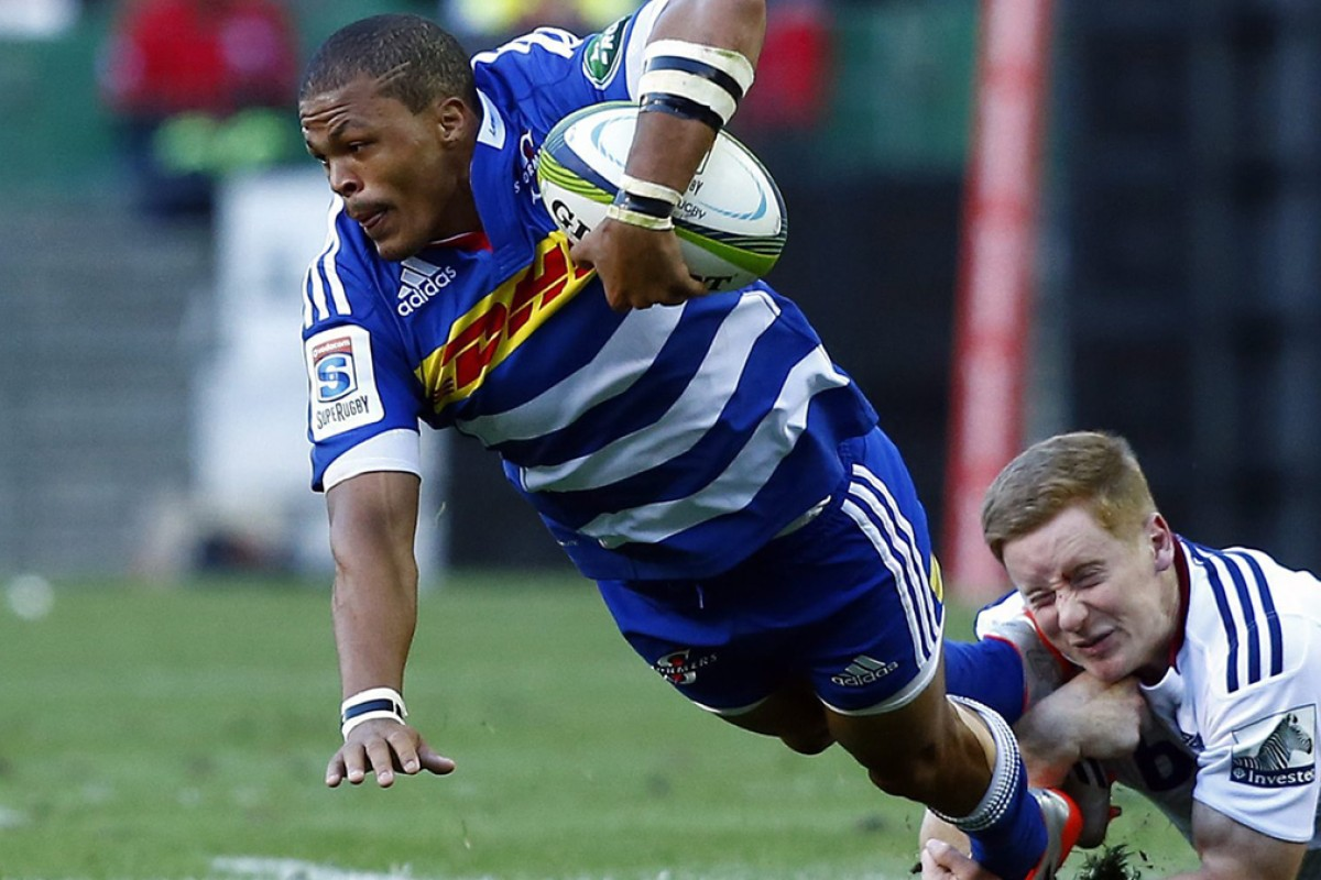 25c93622517 Juan de Jongh of the Stormers is tackled by the Blues' Hamish Northcott  during their
