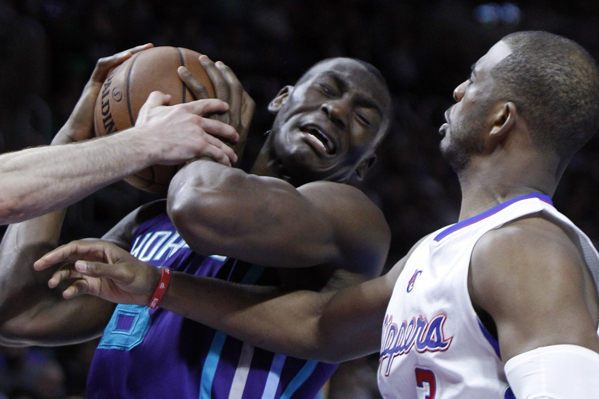 3a78900d The Charlotte Hornets' Bismack Biyombo in action against the Los Angeles  Clippers' Chris Paul