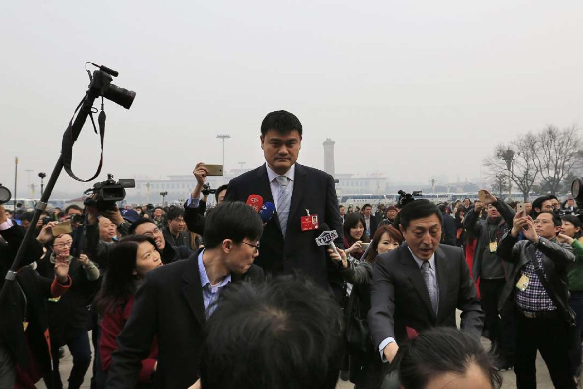 d643f9940c3 Former Chinese NBA star Yao Ming still stands above everyone else as he  arrives for the