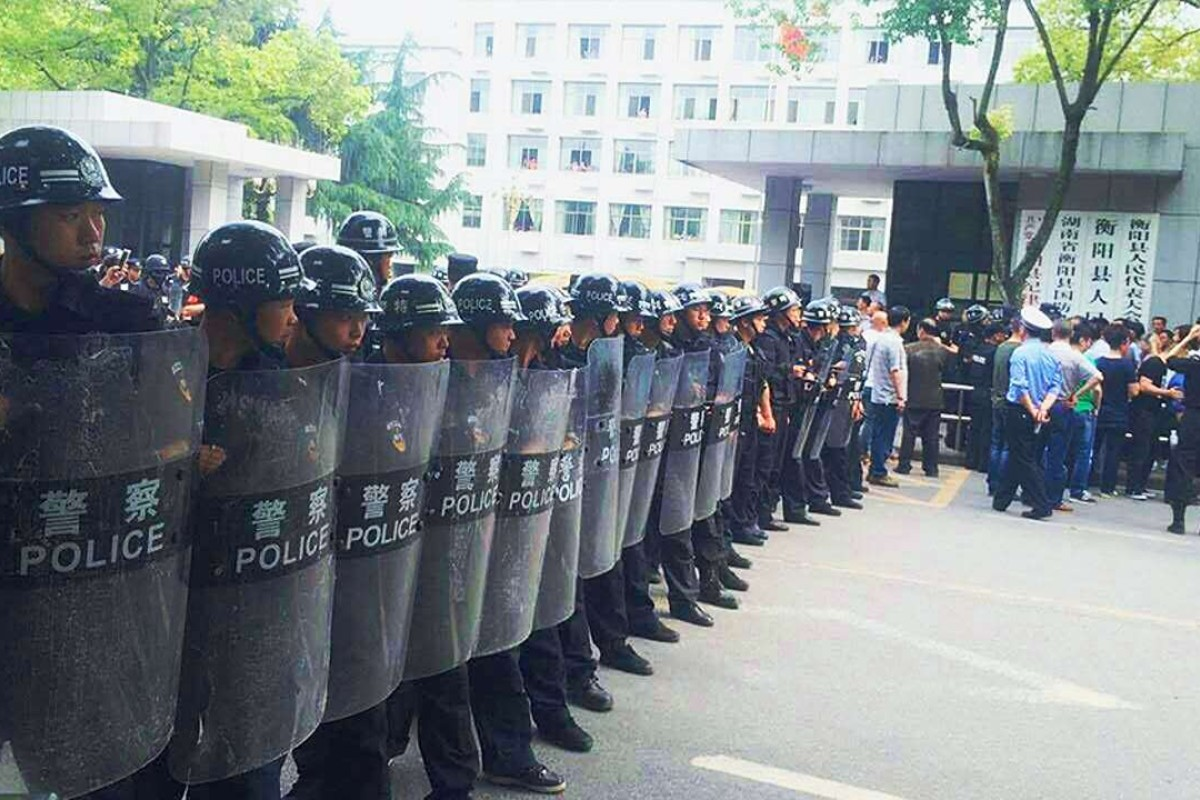 Riot police deployed as teachers in central China stage