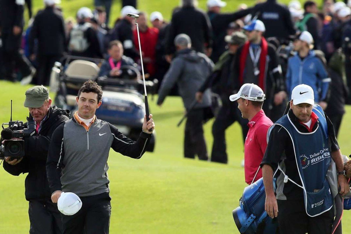 d4797d684d64 Northern Ireland s Rory McIlroy gestures to the crowd as he walks up the  18th fairway on