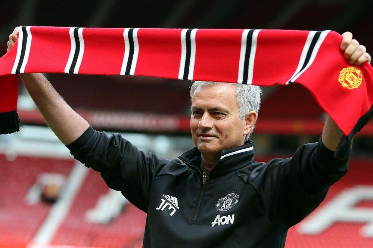 3a4f794ae2e Manchester United s new manager Jose Mourinho with a United scarf as he  faced the media for