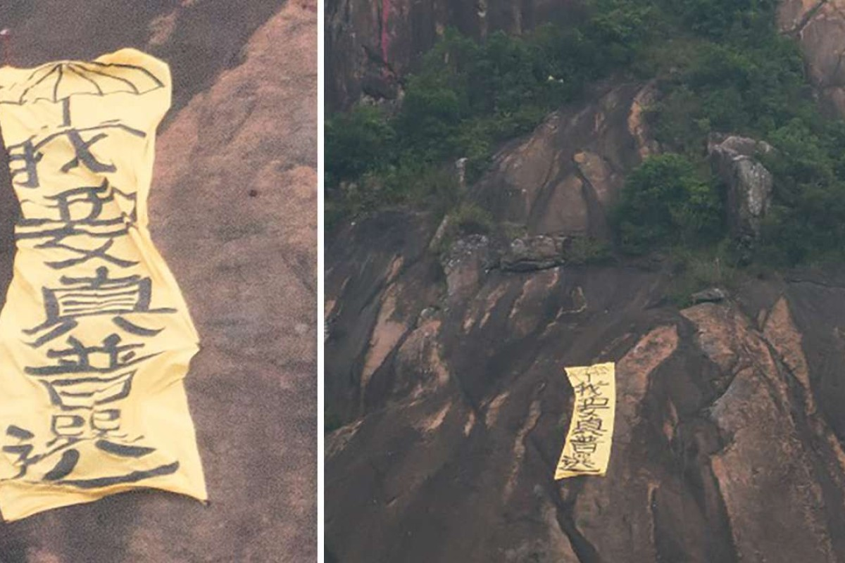 Giant pro-democracy banner dd on Hong Kong hillside to mark ... on