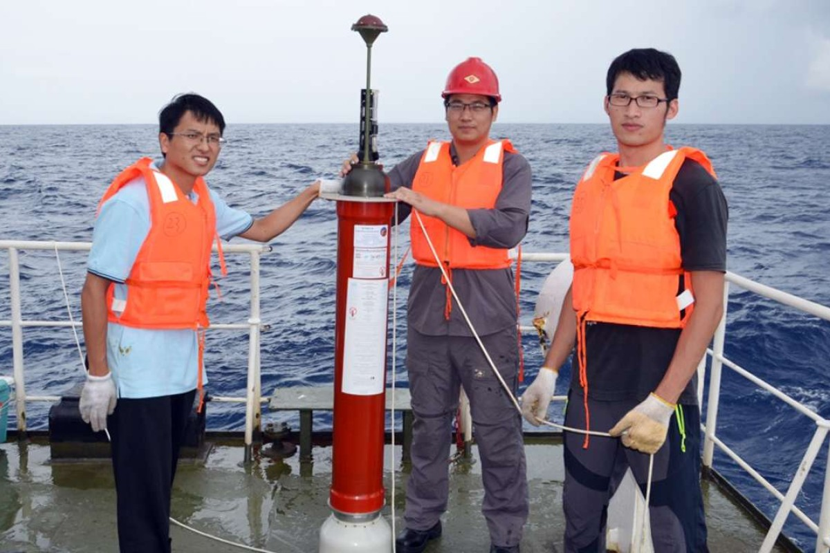 Members of China's Argo project deploy a floating sensor in the South China Sea. Photo: SCMP Pictures