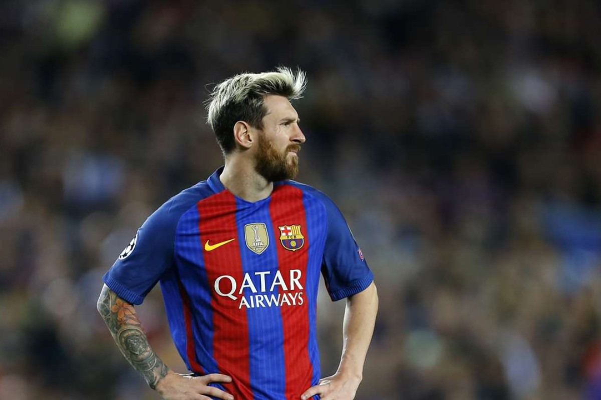 b6d4527a040 Barcelona s Lionel Messi waits to take a free kick during a Champions  League
