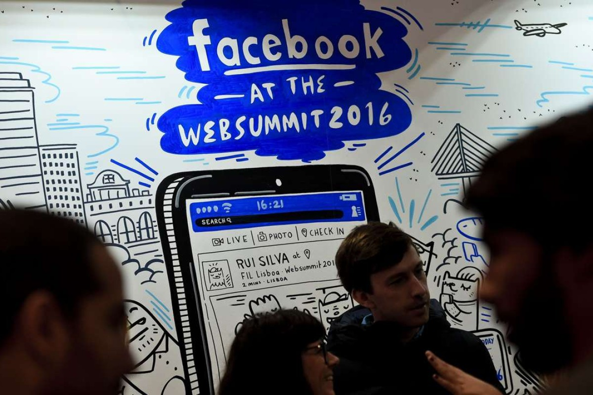 05b207d81c6 Web Summit s attendees gather in front of the Facebook stand during the Web  Summit at Parque