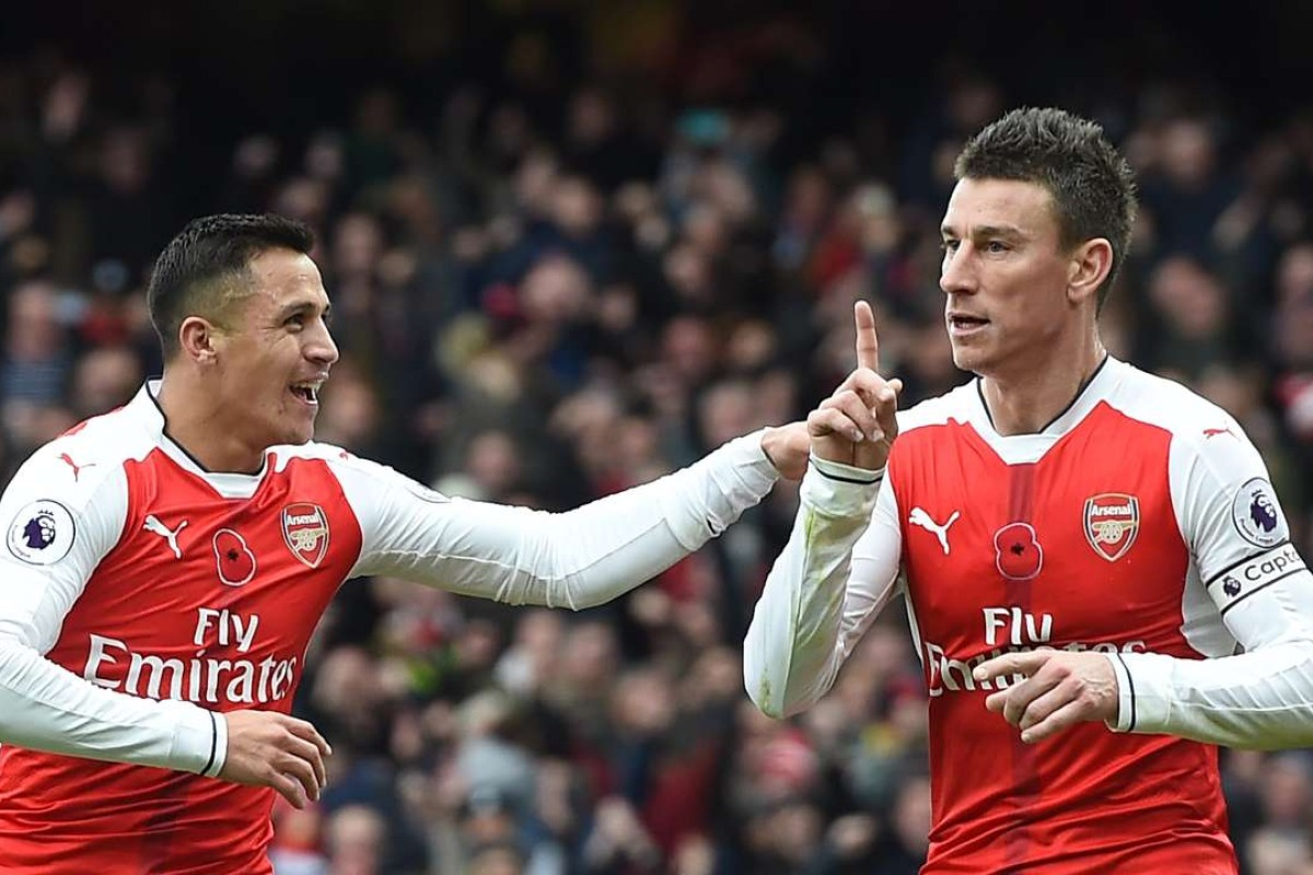 c03cb408d Arsenal s Laurent Koscielny (right) celebrates with Alexis Sanchez after  Tottenham s Kevin Wimmer scored an