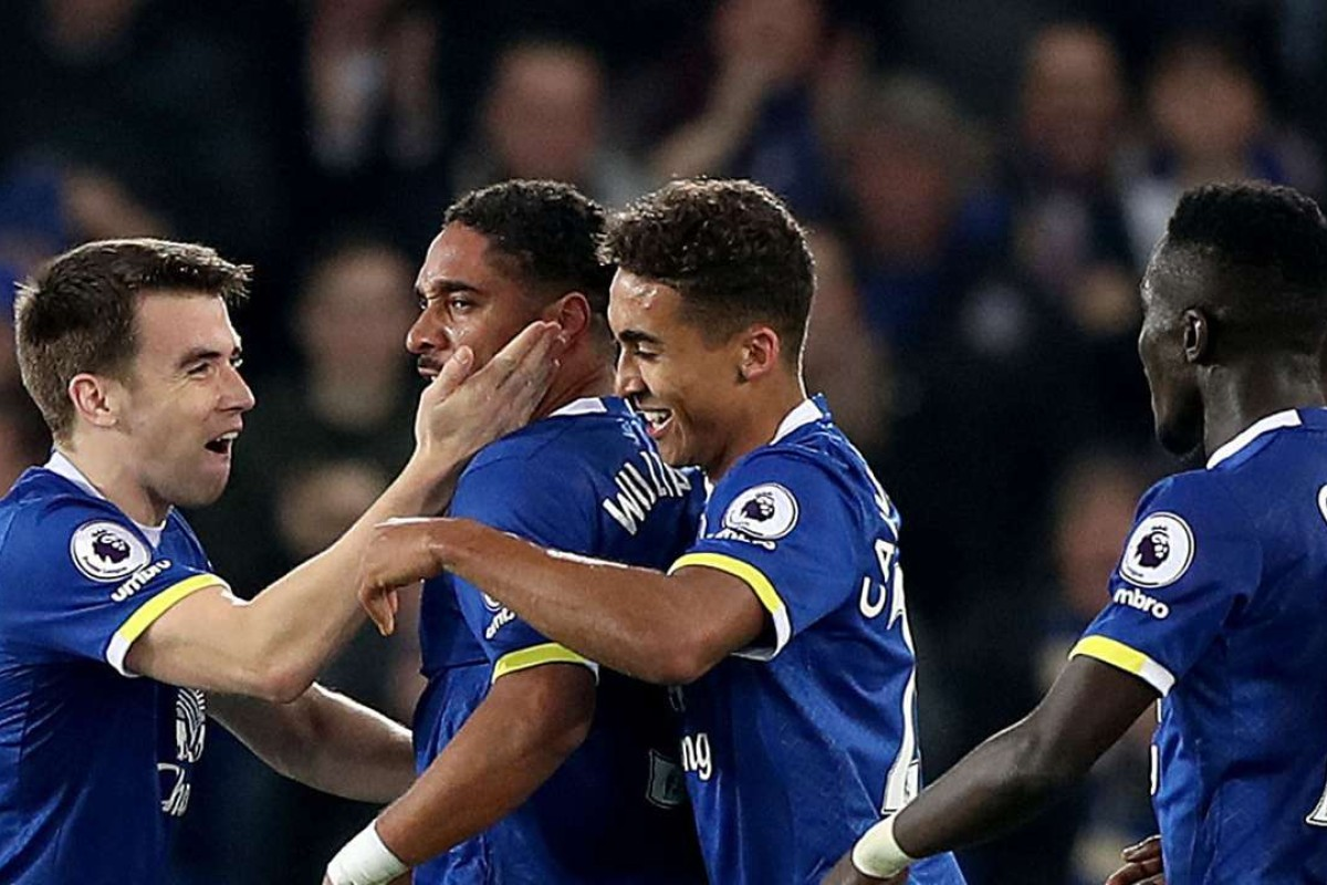 2a85cd9c1 Everton's Ashley Williams, centre left, celebrates scoring his side's  second goal. (Peter