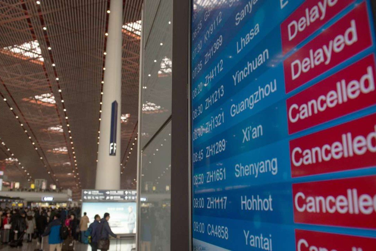 Hundreds of flights cancelled in Beijing as thick smog lays