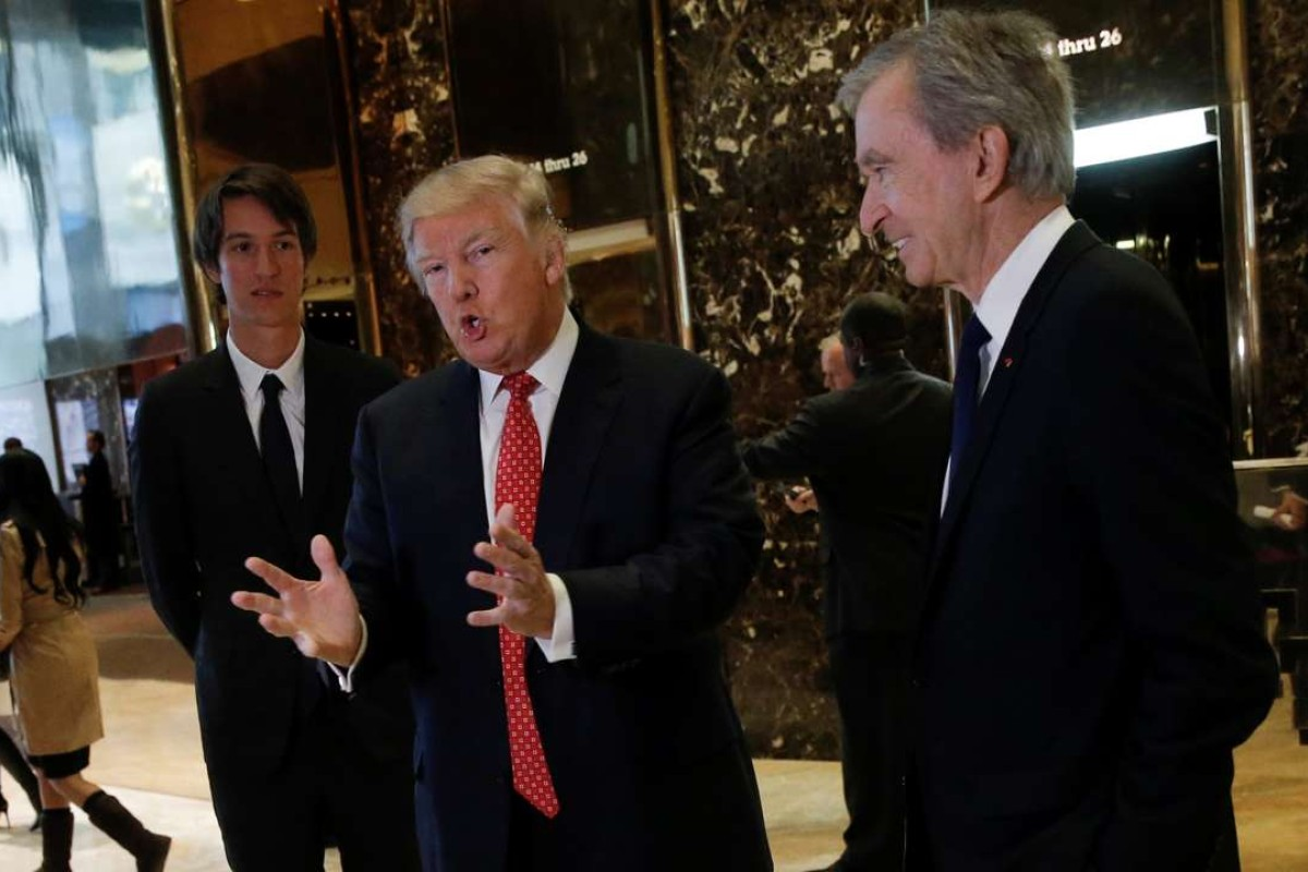 3d45f8e19109 US President-elect Donald Trump speaks to reporters, with LVMH's Bernard  Arnault (right